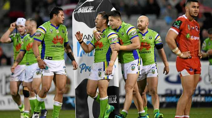 Raiders players celebrate after Elliott Whitehead scored in extra time to win against the Dragons.