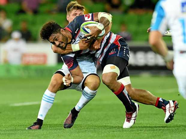 Amanaki Mafi of the Rebels is tackled by Piers Francis of the Blues.