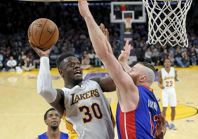 BOSTON BOUND: Australia's Aron Baynes (right) attempts to block Los Angeles Lakers forward Julius Randle.