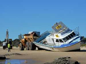 Beached boat moved to final resting place before demolition