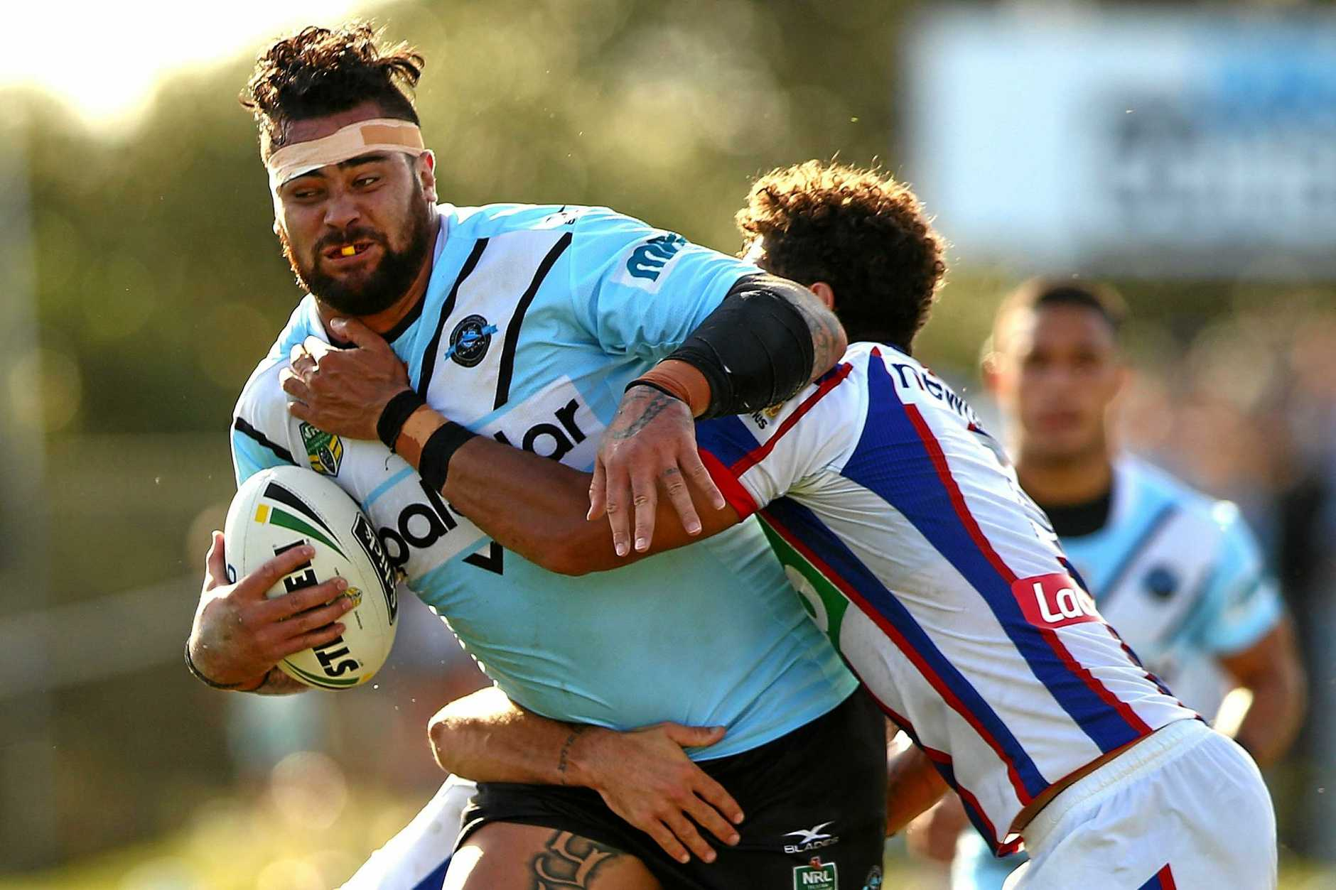 Andrew Fifita of the Sharks is tackled during the round five NRL match against the Knights at Southern Cross Group Stadium.