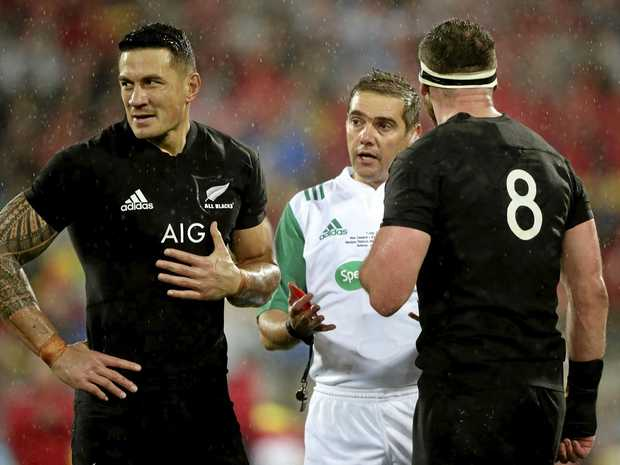 French referee Jerome Garces prepares to show a red card to New Zealand inside centre Sonny Bill Williams (left) as captain Kieran Read looks on during the second Test between the British and Irish Lions and the All Blacks in Wellington.