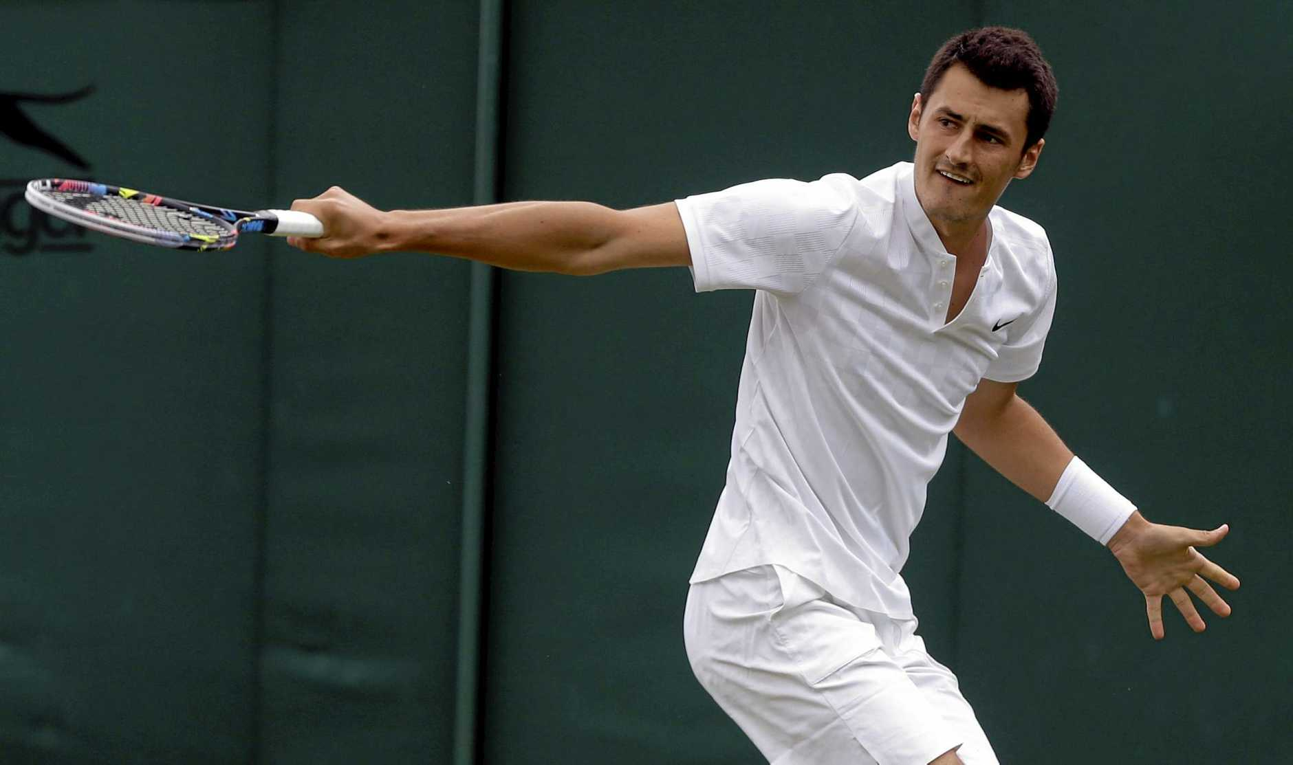 TROUBLED STAR: Australia's Bernard Tomic returns to Germany's Mischa Zverev during their Men's Singles Match on day two at the Wimbledon Tennis Championships in London.