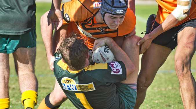 WRAPPED UP: Souths player Matthew Holmes ties up Wattles fullback Jackson Green as both teams strive for the TRL finals.
