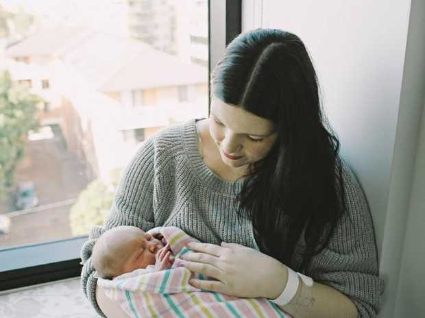 Melissa and her newborn baby, who was fed another mother's breastmilk.Source:Supplied