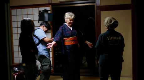 Maggie Beer gets dressed in a traditional kimono in a scene from Maggie in Japan.