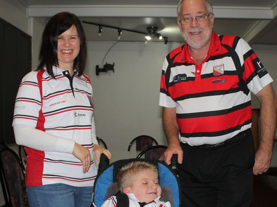 DONATION: Sarah Rubb thanked Toowoomba Rangers' club representative Danny Wiedman (right) for the club's donation of $5000 to help her son Hamish.