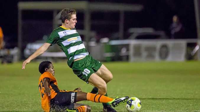 Western Pride footballer Joe Duckworth is tackled by a Brisbane Roar Youth player in an earlier NPL game this season.