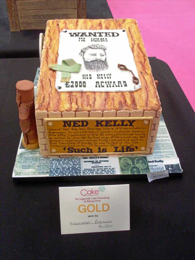 WINNING CAKE: Merivale Cakes and Crafts' student Narelle Brown won gold for her Ned Kelly creation at the Alexandra Palace International Cake Decorating Competition in London.