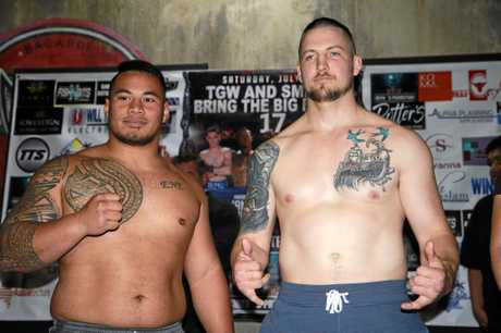 Toowoomba's Herman Ene-Purcell (left) and Randall Rayment at today's weigh-in ahead of their heavyweight clash at Rumours tomorrow night.