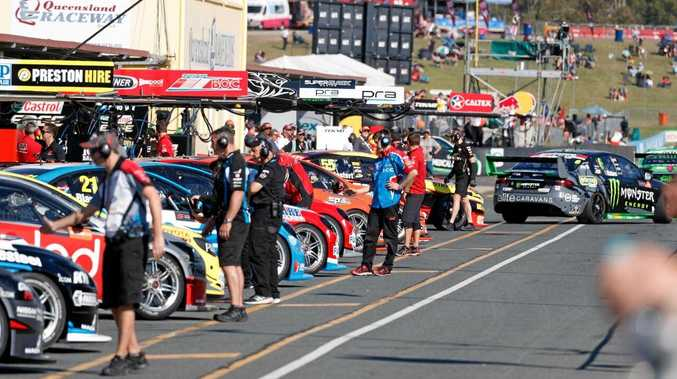 Pit lane action during the annual Ipswich SuperSprint series at Queensland Raceway. Photo: Supercars