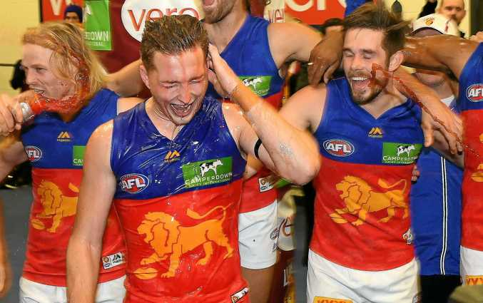 CELEBRATION DAY: Brisbane Lions players enjoy a win over Essendon. The city of Ipswich has had a huge win too with the Lions confirming their training and administration base move to Ipswich.