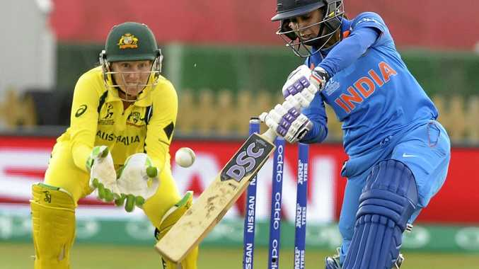 India captain Mithali Raj, right, plays a shot watched by Australia's wicketkeeper Alyssa Healy