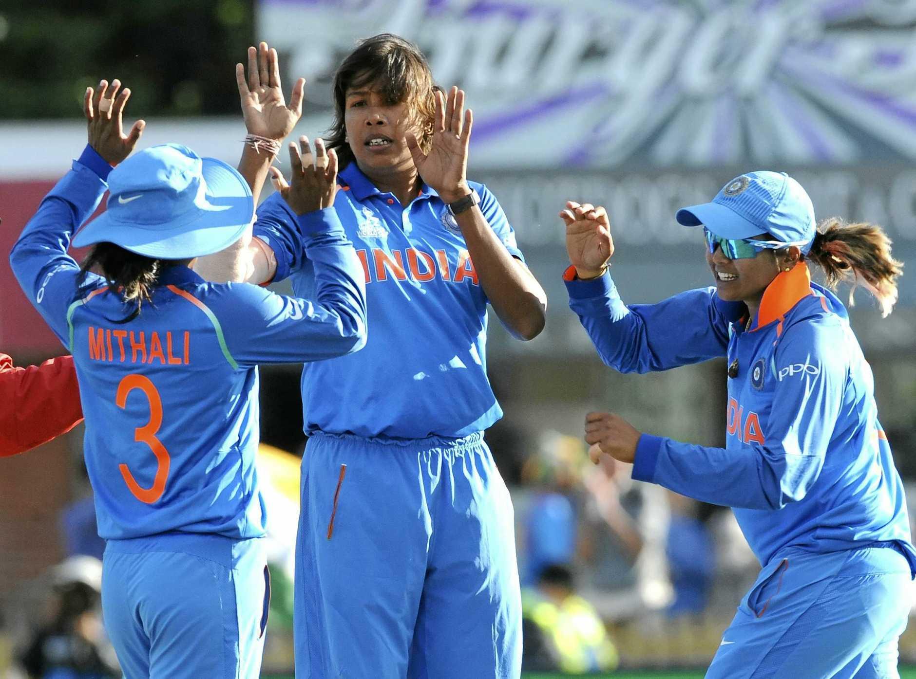 India's Jhulan Goswami, centre, celebrates after dismissing Australia's Alyssa Healy