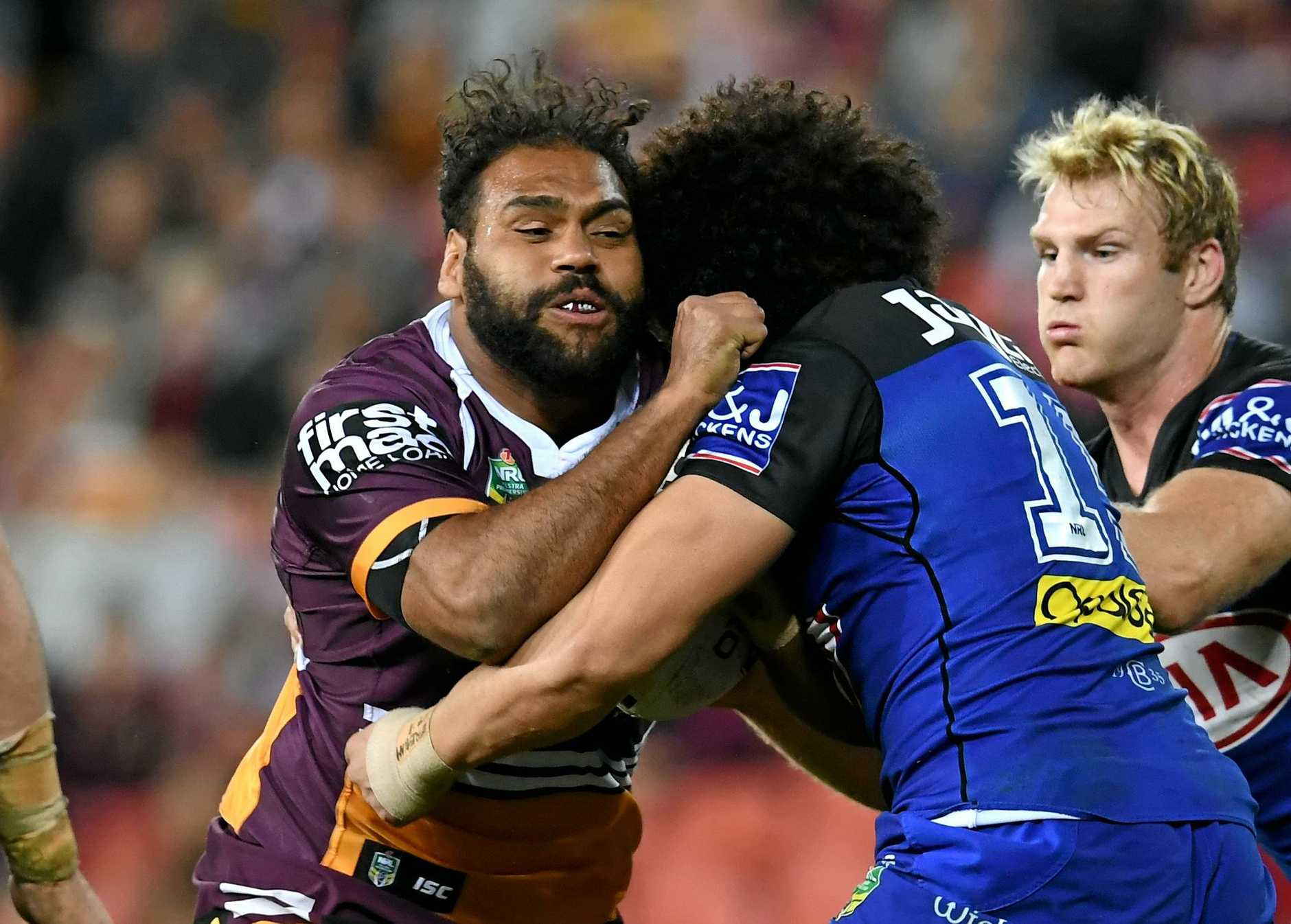 Sam Thaiday of the Broncos (left) is tacked