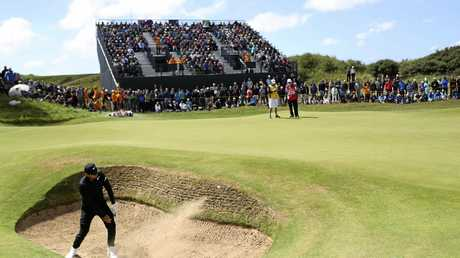 Jason Day plays out of a bunker on the seventh hole at Royal Birkdale.