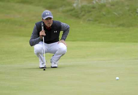 Jordan Spieth of the United States lines up a putt on the 14th hole.