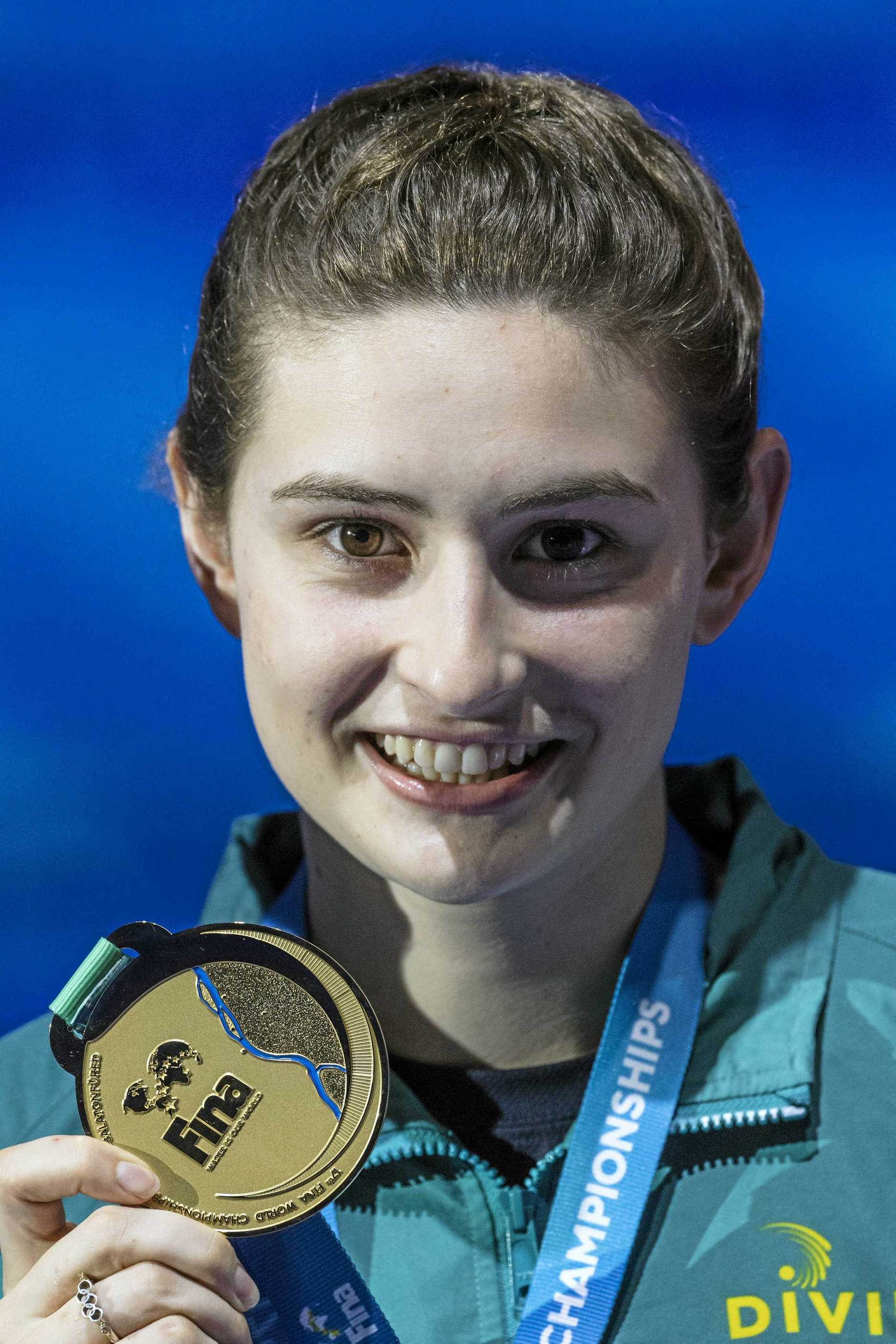 GOLDEN MOMENT: Australian Maddison Keeney was all smiles after winning the women's diving 1m springboard final at the Swimming World Championships.