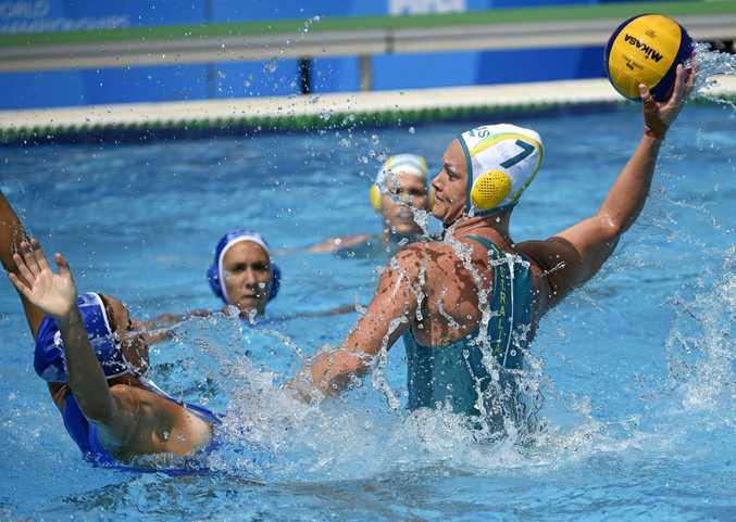 SHOWDOWN: Australia's Rowie Webster (right), throws the ball past Greece's Vasiliki Diamantopoulou, during their women's water polo Group D match.
