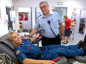 SLEEVES UP: Martin Kelly reassures Rachael Middleton as she gives blood as part of the Red Cross Blood donation drive. Photo: Max Fleet / NewsMail