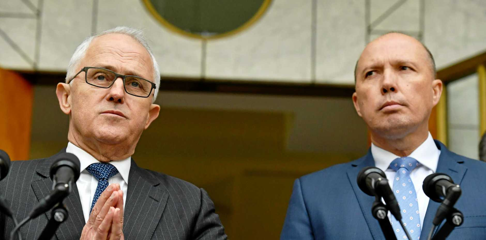 Prime Minister Malcolm Turnbull, left, has put Petter Dutton in charge of all our cops and spies.