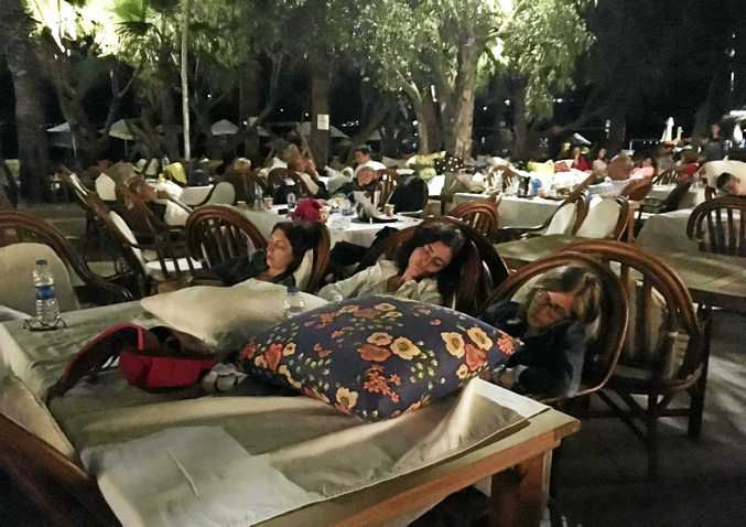 Hotel guests sleep outdoors after abandoning their rooms following an earthquake in Bitez, a resort town about 6km west of Bodrum, Turkey.