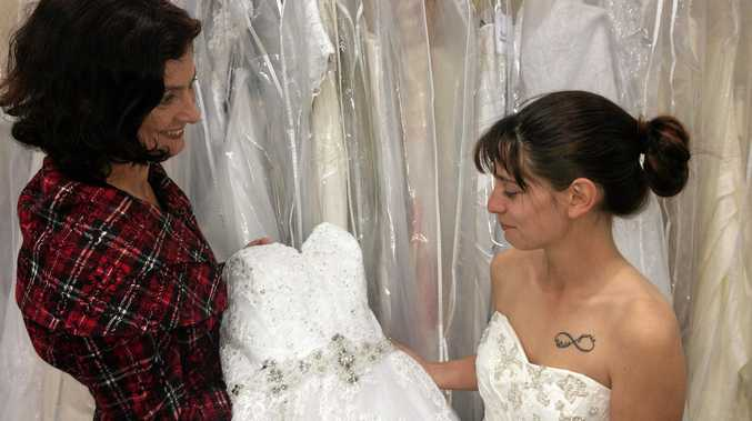 Lasting Impressions owner Leah Stevens helps Grafton bride to be Natalie Jackson find another wedding dress.