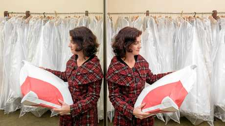 DRESS CODE: Lasting Impressions' Leah Stevenson is about to send a gown to Canberra after the collapse of maker Alfred Angelo.