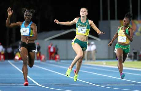 Julien Alfred of Saint Lucia crosses the finish line to win the Girls 100m final ahead of Australia's Riley Day.