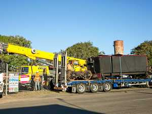 BIG LIFT: The tender being lowered onto the back on an awaiting truck.