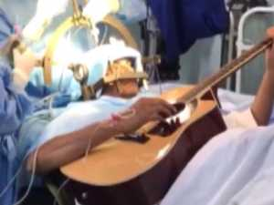 Man plays guitar during seven-hour brain surgery