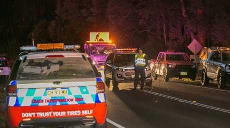 Police crash investigators at the scene last night. Picture: Damian Hoffman