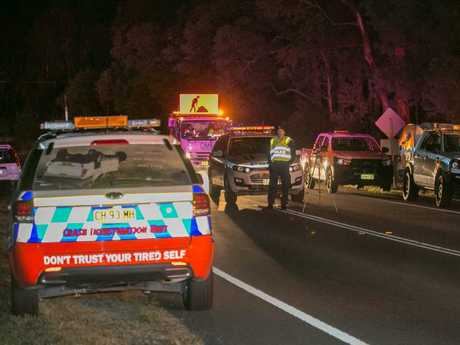 Police crash investigators at the scene last night. Picture: Damian Hoffman