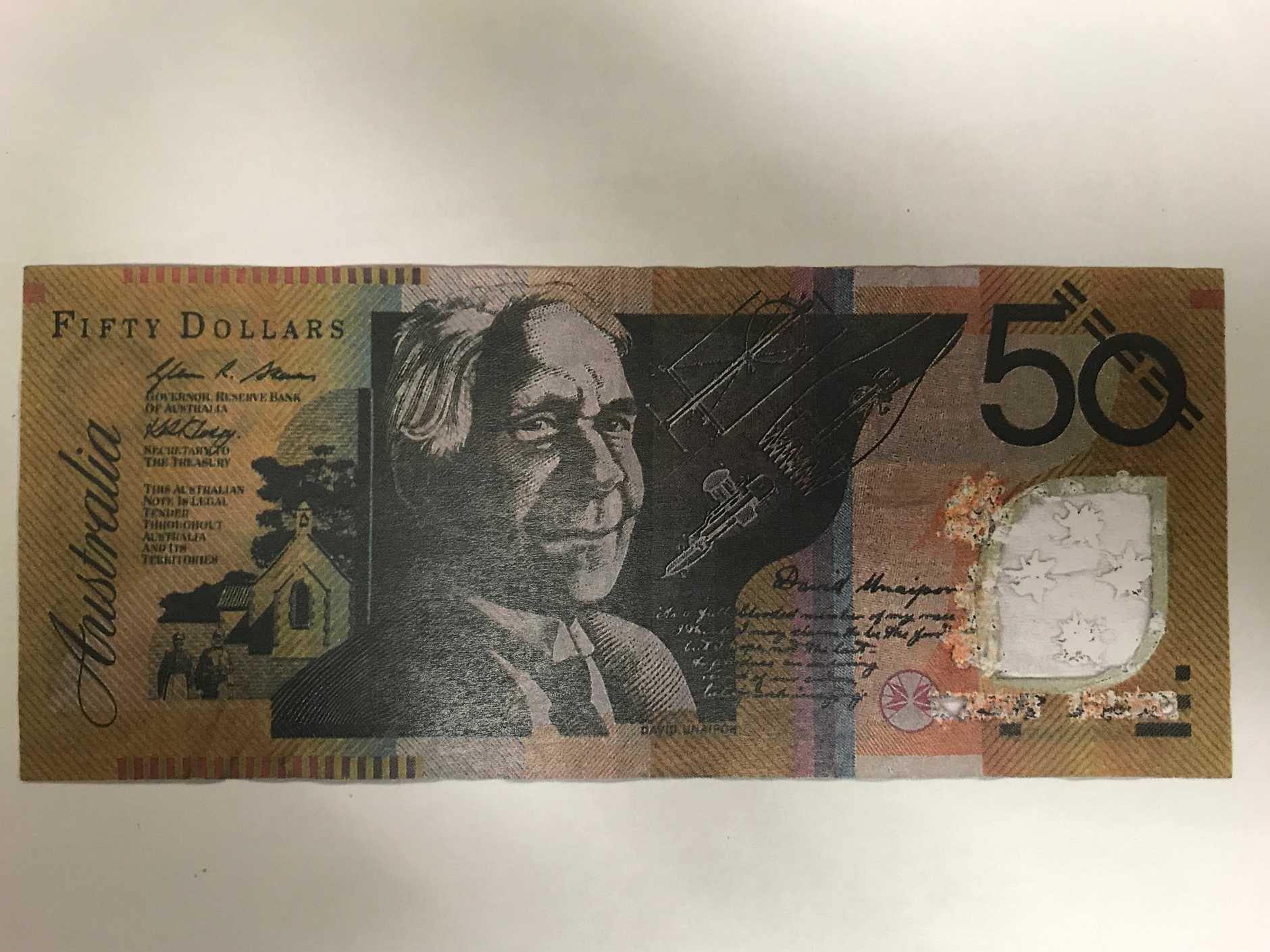 A man has been arrested after the alleged use of counterfeit money in Warwick.
