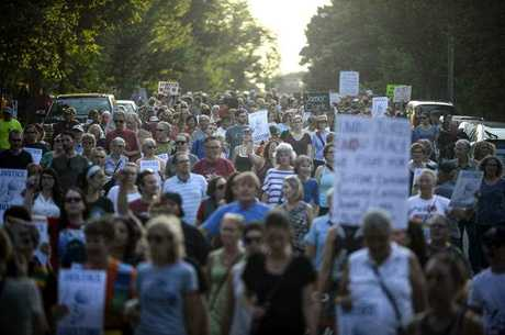 Hundreds march from the site of Justine Damond's shooting to Beard's Plaissance Park during a march in honor of Damond Thursday, July 20, 2017, in Minneapolis. Damond, of Australia, was shot and killed by a Minneapolis police officer on Saturday, July 15 after calling 911 to report what she believed was a possible assault.