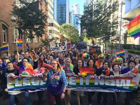 Protestors march on Brisbane's George St during a same-sex marriage rally opposing the Liberal government's plebiscite, Saturday, June 25, 2016.