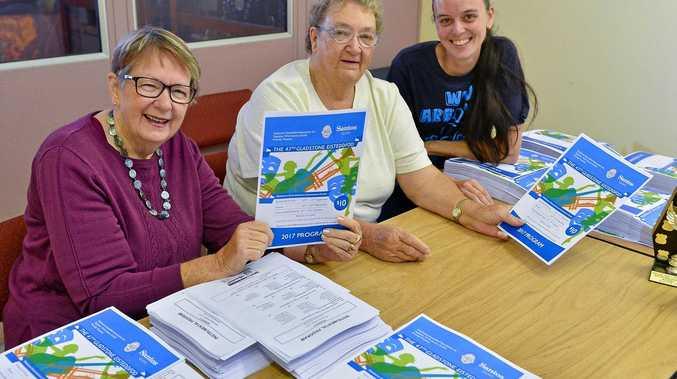 NEARLY HERE: Gladstone Eisteddfod's Beth Jones, Pauline Newman and Heidi Johnson prepare this year's event program.