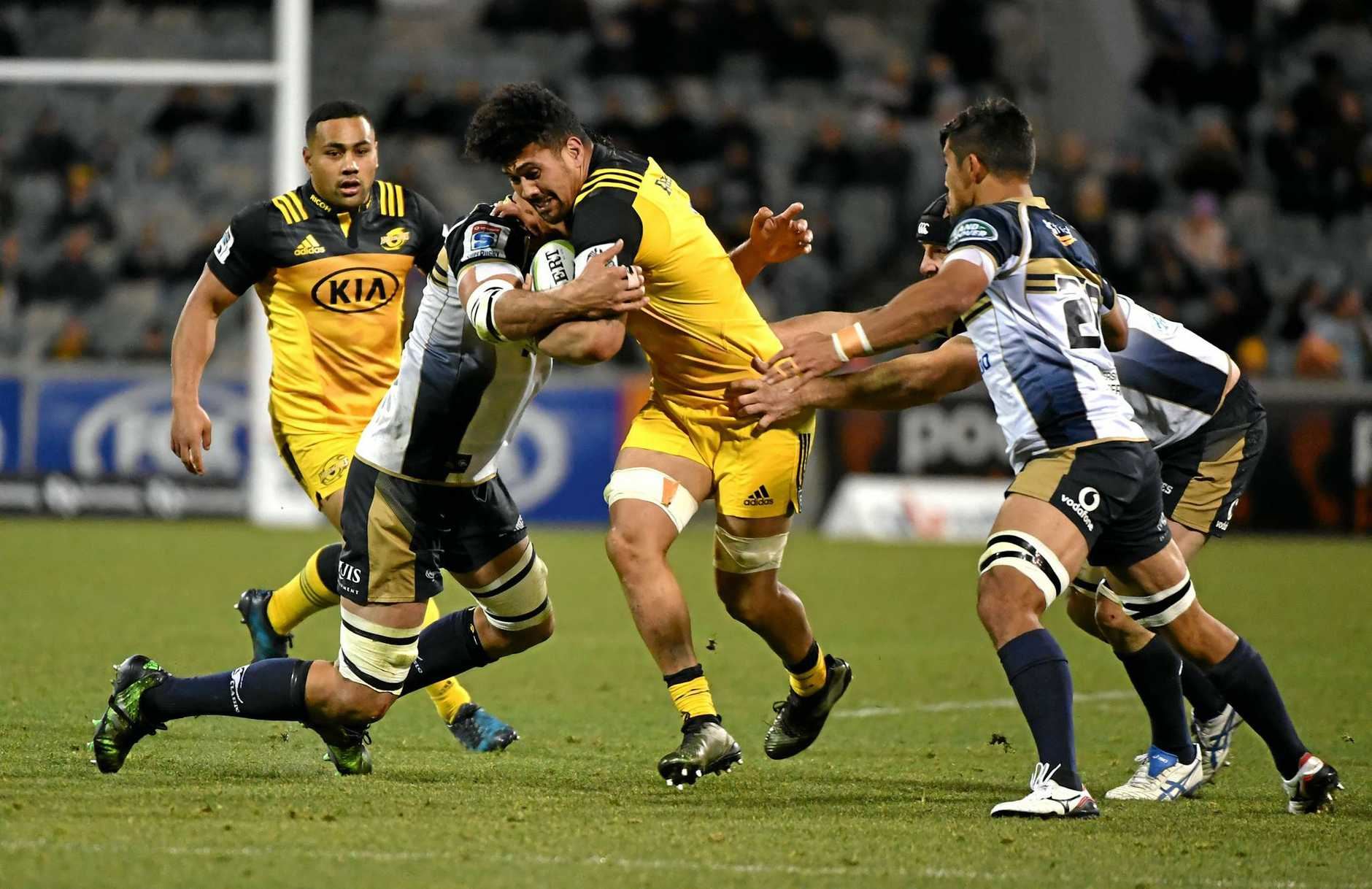 Ardie Savea of the Hurricanes (centre) is tackled during the quarterfinal Super Rugby match between the Brumbies and the Wellington Hurricanes at GIO Stadium in Canberra, Friday, July 21, 2017. (AAP Image/Mick Tsikas) NO ARCHIVING, EDITORIAL USE ONLY