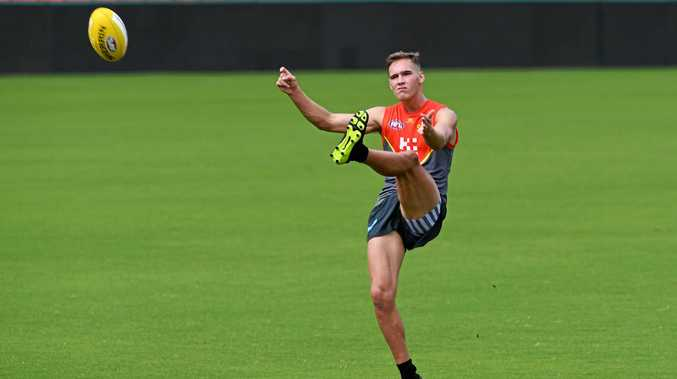 Jack Scrimshaw kicks during a Gold Coast Suns training session at Metricon Stadium.