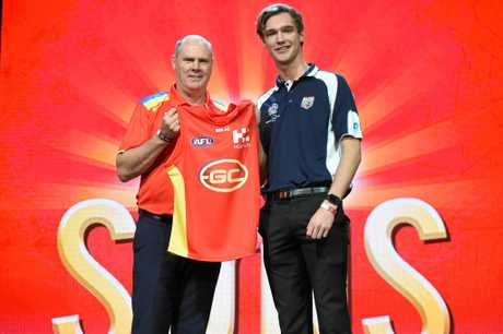 Jack Scrimshaw (right) with Gold Coast Suns coach Rodney Eade during the AFL Draft.