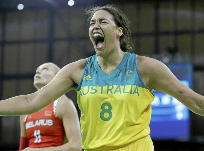 Australian centre Liz Cambage reacts after making a basket and receiving a foul at the Rio Olympics.