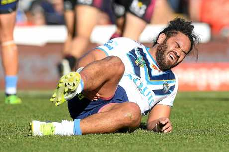 Konrad Hurrell of the Titans reacts after sustaining an injury.