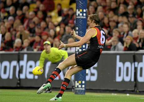 Joe Daniher scores a goal for the Bombers against North Melbourne.