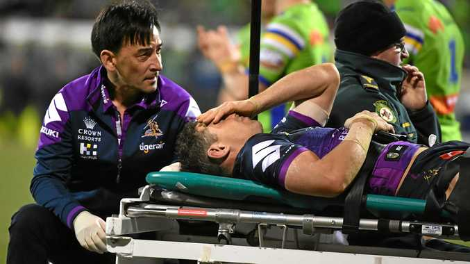 Billy Slater of the Storm is carried off after being knocked out against the Raiders.