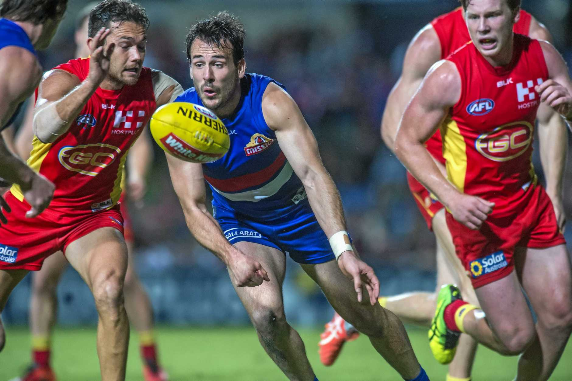 Tory Dickson of the Bulldogs gets a pass away during the Round 17 AFL match between the Western Bulldogs and the Gold Coast Suns at Cazalys Stadium, Cairns, Saturday, July 16, 2016. (AAP Image/Brian Cassey) NO ARCHIVING, EDITORIAL USE ONLY