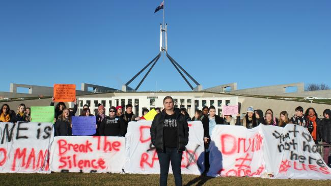 Freya (centre) joined other students to protest at Parliament House to demand that universities respond to the issue of rape on campus.