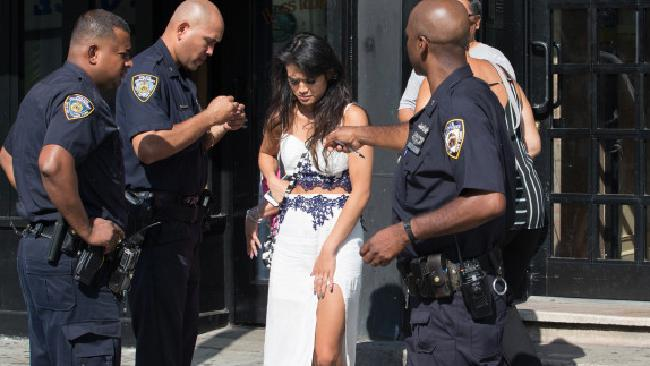 Therese Hipolito is escorted from a New York bar after being locked in overnight. Picture: New York Post Source:Supplied