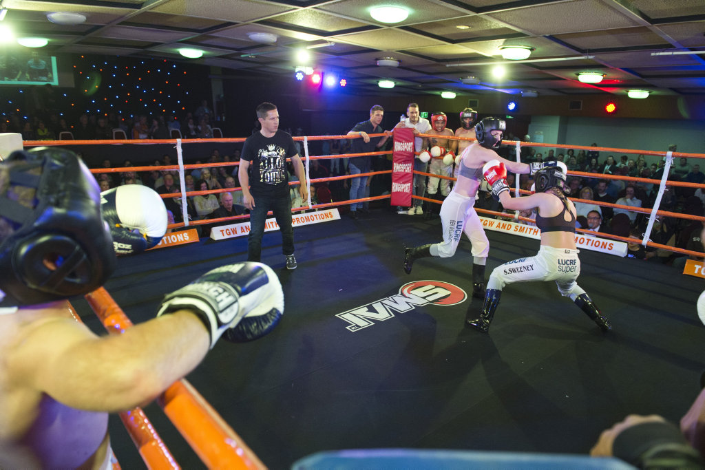 Bek Williams (left) and Sally Sweeney in the jockey tag team fundraiser fight at TGW and Smithy Bring The Big Fights 17 at Rumours International, Saturday, July 22, 2017.