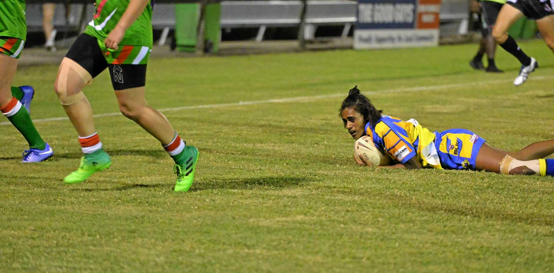 BIG EFFORT: Mel Tass opens the scoring for Souths Sharks in their grand final against Sarina.