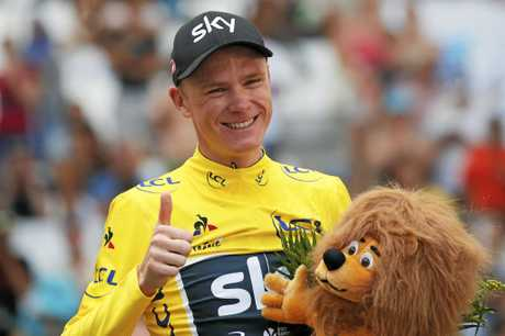 Britain's Chris Froome, wearing the overall leader's yellow jersey, flashes a thumbs up on the podium after the 20th stage of the Tour de France  in Marseille